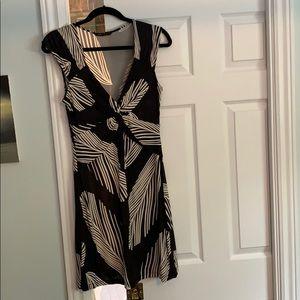 BcbgMaxAzria palm leaf low cut jersey dress.